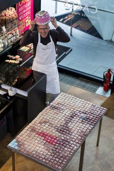 Gerhard Jenne. A pixelated portrait of The Queen made out of 3,120 cakes, one for each week of her reign, will be made by bakers Konditor & Cook as part of the Jubilee weekend celebrations.