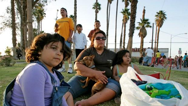 Mexicali residents sit on a grassy area just over the border after a 7.2 magnitude earthquake struck the area April 4.