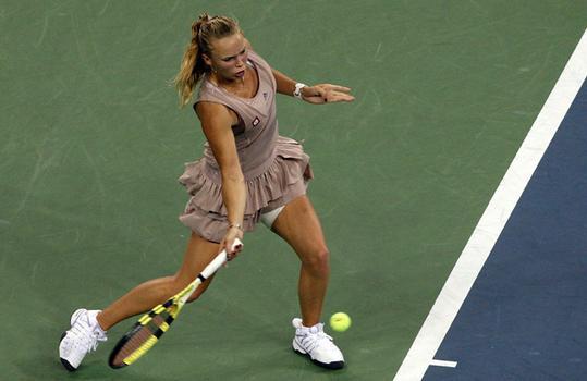 Caroline Wozniacki of Denmark returns a shot against Melanie Oudin.
