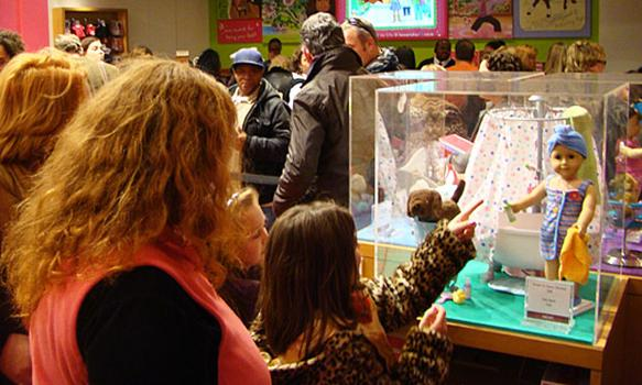 More customers queue up to buy an American Girl doll.