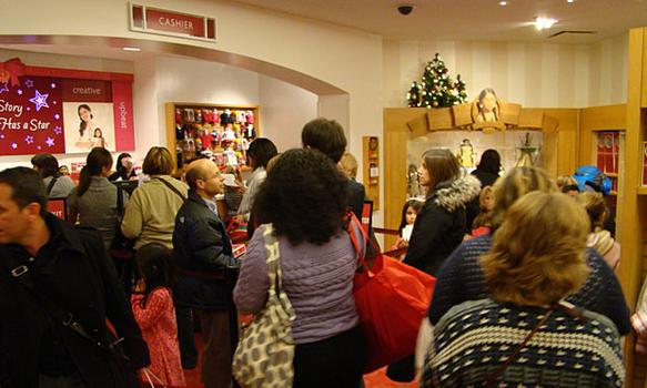 Customers are lined up to buy an American Girl doll.