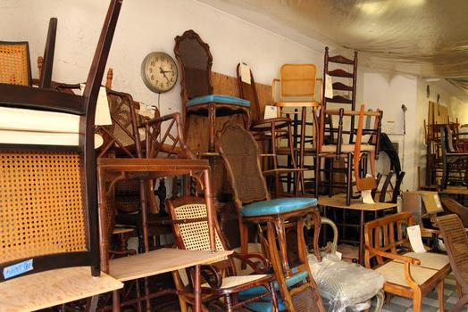 A jumble of chairs at Veteran's Chair Caning and Repair.
