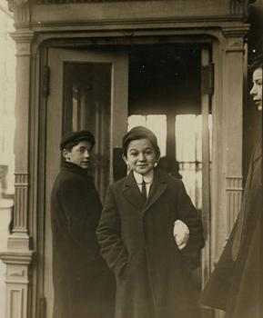 Entrance to Wanamaker's New York store, 8:30 AM, 1910. This photo is from the records of the National Child Labor Committee.