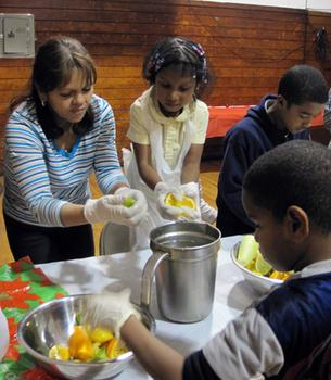 Families cook together at a healthy eating class in the South Bronx.