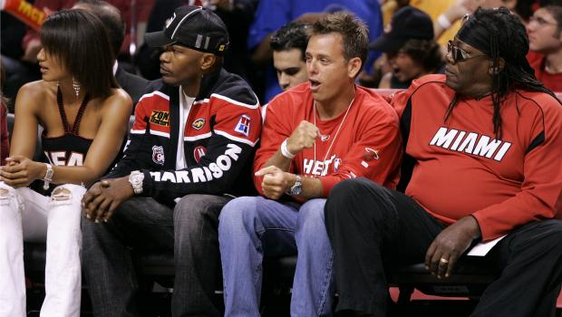 Actor Jamie Foxx (2nd L) and Clemons (R) attend Game Seven of the Eastern Conference Finals between the Detroit Pistons and the Miami Heat in 2005.