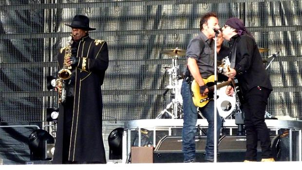 Clarence Clemons plays while Springsteen takes the mic in Dublin, Ireland in 2009.