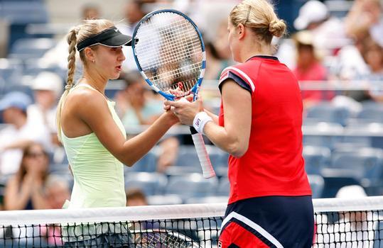 Kim Clijsters of Belgium, R, with Viktoriya Kutuzova.