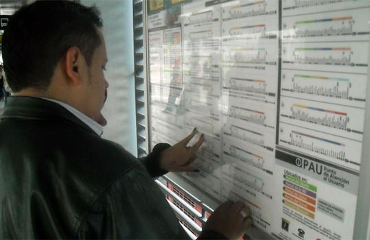 A passenger studies the Transmilenio map in Bogota.