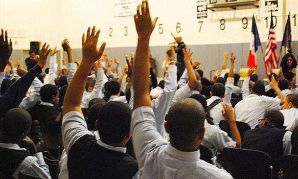 The students participated by waving their hands in the air.