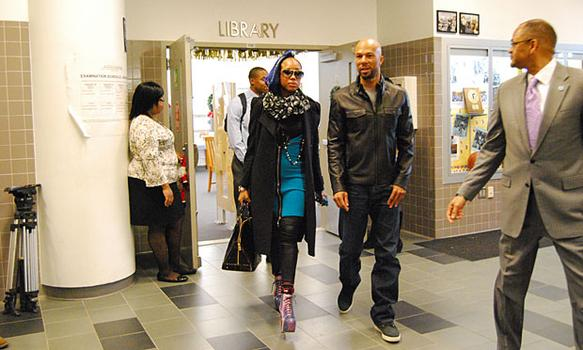 Common with a friend visited Eagle Academy's library before they headed to the auditorium on Monday.