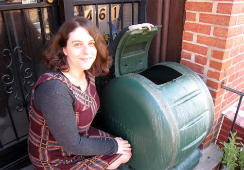 Diane Debicella creates compost on the front stoop of her apartment.