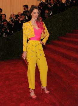 Model Coco Rocha got her hair done match her outfit.