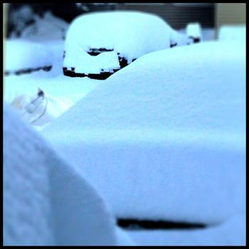 Snow covered cars in Connecticut on January 27, 2011.