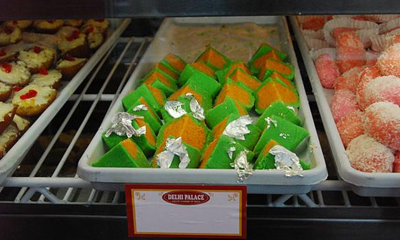 Delhi Palace on 74th St. in Jackson Heights, Queens has been busy selling sweets during Diwali. Here, chandrakalla, green and yellow sweets with silver foil and pink cham cham.