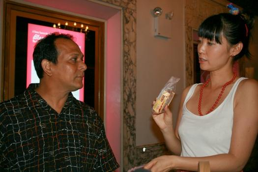 Takagi handed some Parle-G Indian cookies to Dev Mehra, who is from India but lives in Jackson Heights.