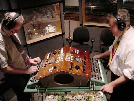 Leon Dewan (left) and Brian Dewan, primates, operate the Dual Primate console.