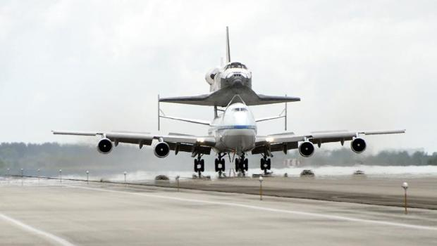 Space shuttle Discovery sits atop the Boeing 747 Shuttle Carrier Aircraft after touching down at NASA's Kennedy Space Center in Florida. This is how the shuttles would end up at their new homes.