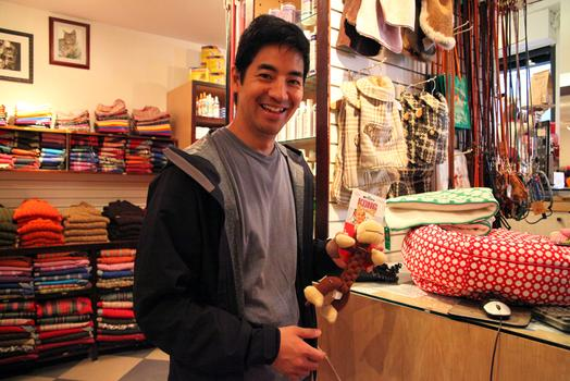 Craig Koketsu holding a toy for his new puppy.