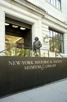 The exterior of the newly remodelled New York Historical Society Museum and Library. A bronze statue of Frederick Douglass greets visitors.