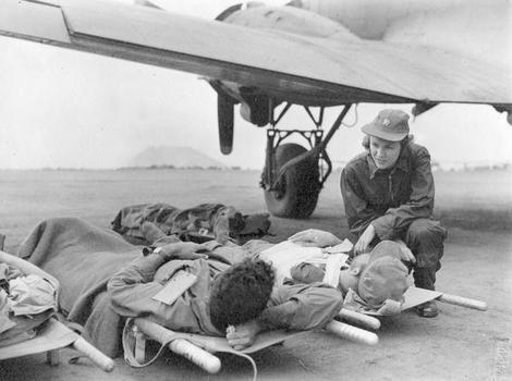 Flight Nurse and Wounded. Iwo Jima Airfield, 1945