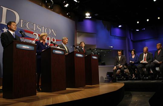The four candidates, the panelists and moderator.
