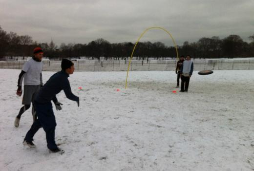 People playing snow frisbee in Prospect Park.
