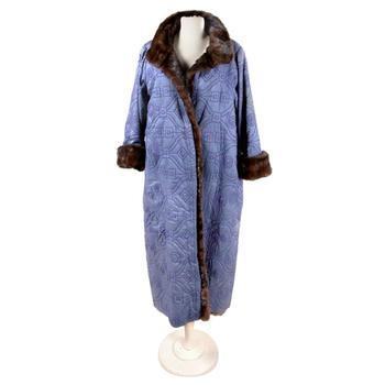 A size 8 Giorgio di Sant' Angelo Reversible Mink Coat sold for $8,150 at auction Wednesday. It was estimated to sell for$500.
