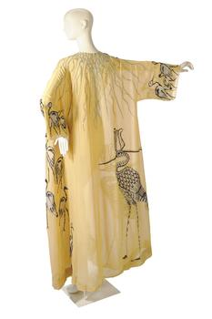 "The Irene Sharaff saffron yellow chiffon robe embroidered with a Sacred Ibis that Taylor wore in ""Cleopatra"" is also up for auction."
