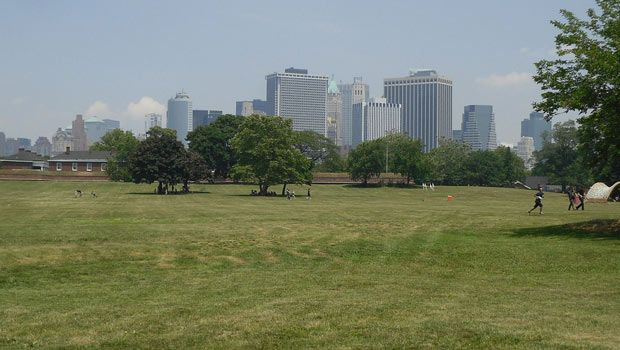 The lawn at Governors Island awaits Frisbee throwers, blanket loungers, and daytime joggers.