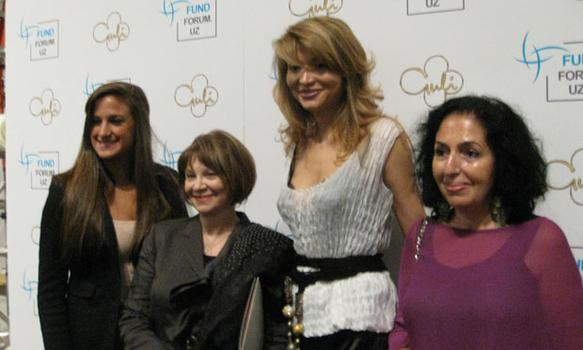 Gulnara Karimova (third from left) towers over Uzbek expats