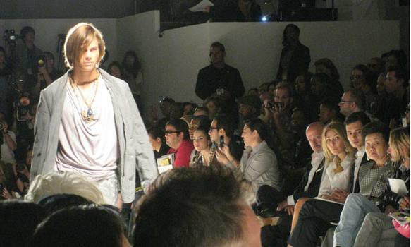 One of the few male models on the catwalk in the GULI collections show