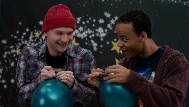 "Jacob Moore and Mark St. Cyr experimenting with balloons in ""Happy Worst Day Ever."""