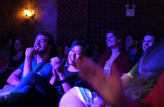 The audience reacts to the entrance of a surprise guest, the drummer and producer Questlove of The Roots.