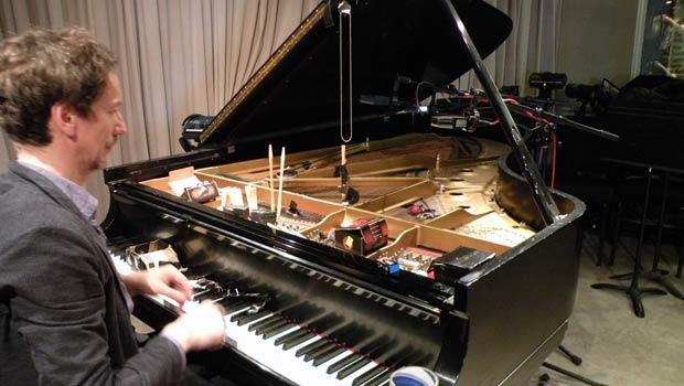 Hauschka (Volker Bertelmann), tests out his preparations on our Steinway