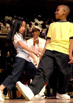 Hendricks appluading a kids' dance group at the Roy Thompson Hall in Toronto in 2008.