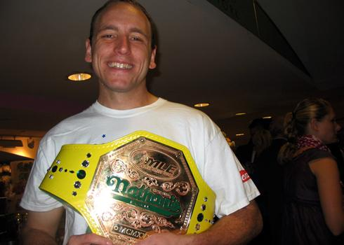 Joey Chestnut and the championship mustard belt.