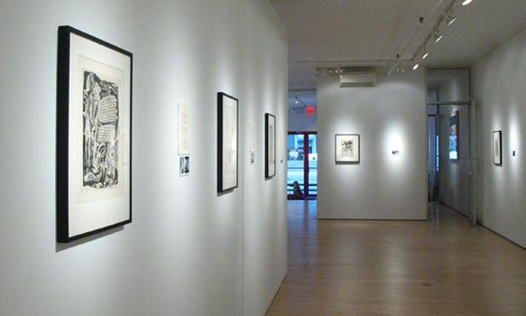 An installation shot of '21 Etchings and Poems,' which is on view now at Woodward Gallery.