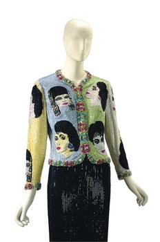 "The auction includes items from five decades of Taylor's life, including this Versace beaded evening jacket from 1992 called ""The Face."" It features portraits of Taylor in her most prominent roles."