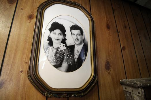 A photograph of Jerry Ragusa's parents hangs in Grande Monuments.