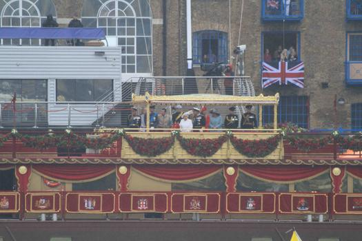 The royal family, including the Queen, Prince Philip, Prince Charles, the Duchess of Cornwall, the Duke and Duchess of Cambridge and Prince Harry review the flotilla ships from the royal barge.