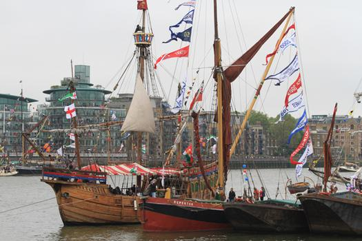 Historic tall ships that would not fit under some of London's bridges waited at the end of the flotilla route to meet the Queen.