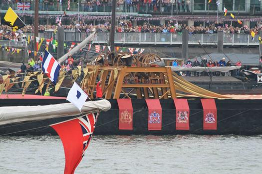One of the musical barges - this one with bells - made its way along the Thames.