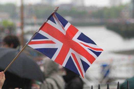 Rain did not dampen the spirits of the revelers, who lined the banks of the Thames to watch the festivities.