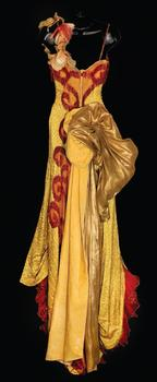 The gown, which sold for $510,000 at auction, is covered with bugle beading, red fringe accents and a gold velvet train with red netting.