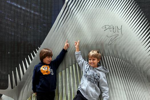 Parents brought their children down to Ground Zero to see the construction and the site of the 9/11 attacks.