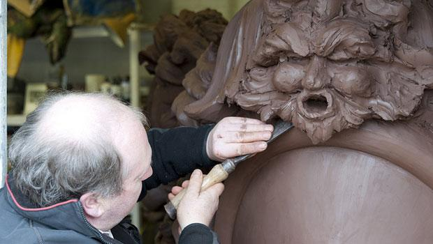Alan Lamb, head of historic carving at City & Guilds of London Art School moulding the Prow sculpture for the Royal Barge.