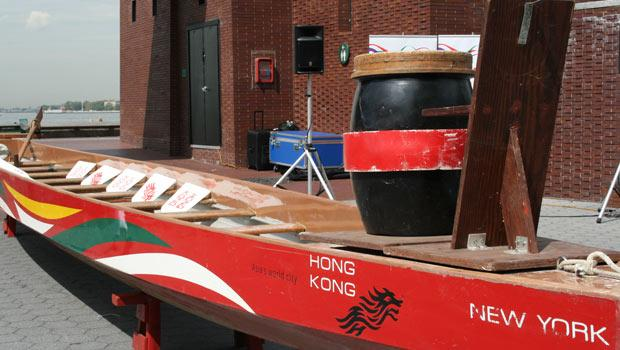 Each dragon boat is piloted by up to 20 crewman, including a steerer and a drummer.