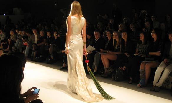 This model walked the catwalk on her own in this wedding-esque gown