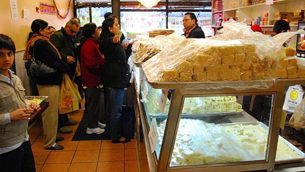 Sukhdev Bawa, the owner of Maharaja Sweets and Snacks, handles several Diwali orders.