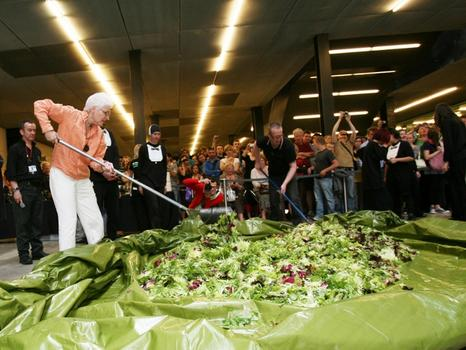 Get ready to veg: artist Alison Knowles is going to make a truly ginormous salad on the High Line this weekend. Seen here: a similar performance at the Tate Modern in London, back in 2008.